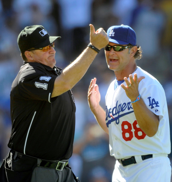 . Dodgers\' manager Don Mattingly argues with umpire Tony Randazzo after the Marlins completed a double play in the seventh inning only to be overturned after an umpire meeting and Andre Ethier was called out for obstruction, Sunday, August 26, 2012, at Dodger Stadium. (Michael Owen Baker/Staff Photographer)