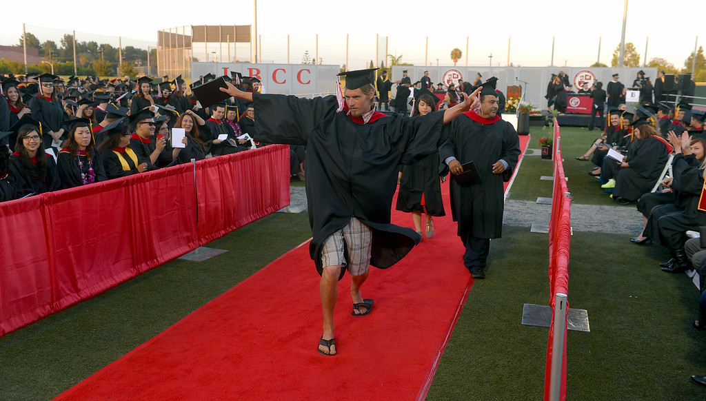 . A Long Beach City College graduate dances down the aisle after receiving his degree at Veterans Memorial Stadium in Long Beach, CA on Thursday, June 5, 2014. (Photo by Scott Varley, Daily Breeze)