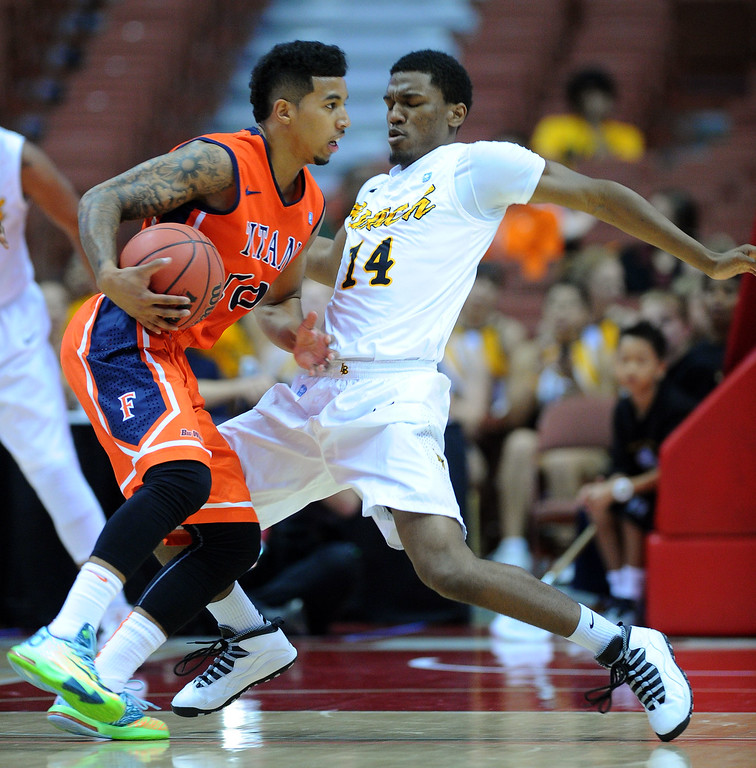 . LBSU\'s Branford Jones falls as CSUF\'s Michael Williams makes a move at the Honda Center in Anaheim, CA on Thursday, March 13, 2014. Long Beach State vs CSU Fullerton in the Big West men\'s basketball tournament. 1st half. LBSU won 66-56.  Photo by Scott Varley, Daily Breeze)