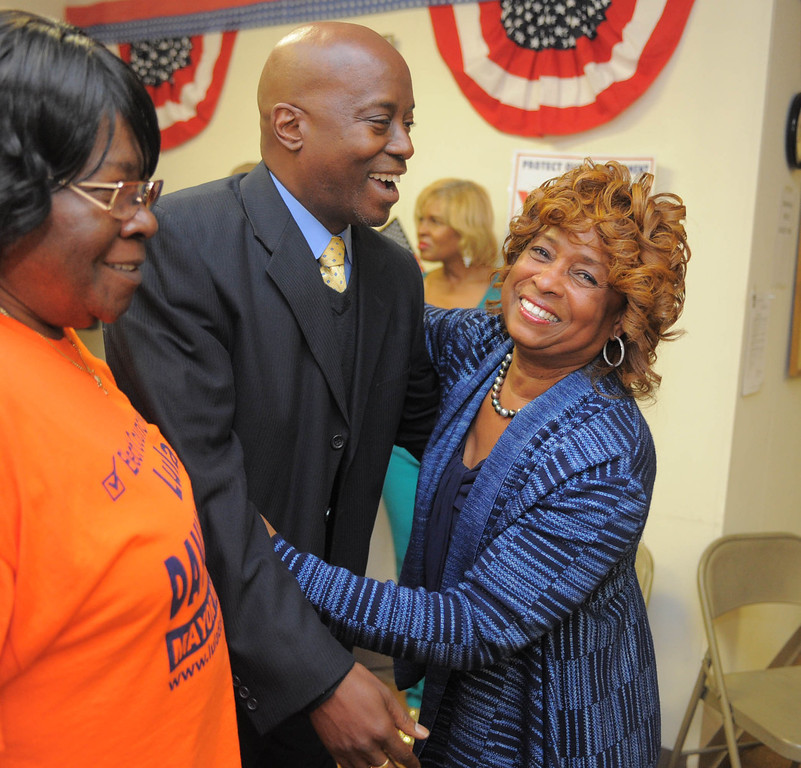 . an Hiller)- Carson Councilwoman Lula Davis-Holmes greets Long Beach City Councilman Steven Neal at her election night campaign headquarters as she and Mayor Jim Dear were in a tight race for mayor late Tuesday night in Carson.