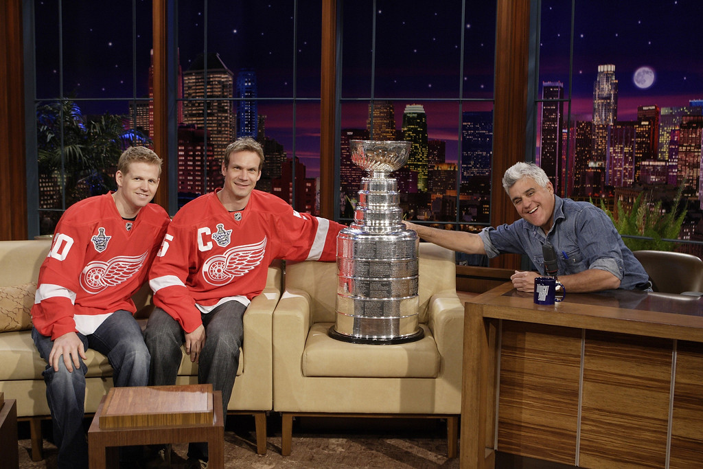 """. In this photo provided by NBC, from left, Detroit Red Wings hockey players Chris Osgood and Nicklas Lidstrom, from Sweden, and host Jay Leno are shown with the Stanley Cup trophy prior to the taping of \""""The Tonight Show with Jay Leno\"""" in Burbank, Calif., Tuesday June 10, 2008. (AP Photo/NBC, Margaret Norton) ** EDITORIAL USE ONLY, NO SALES, NO ARCHIVES **"""