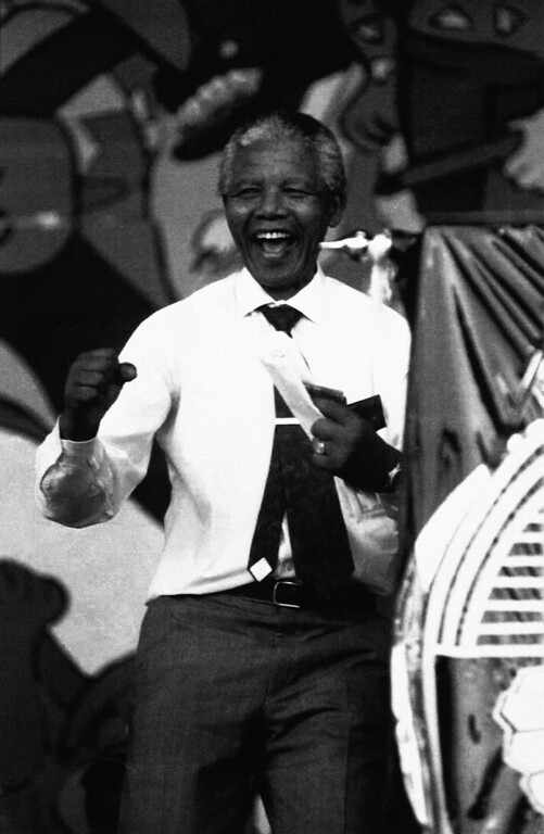 . President of the African National Congress Nelson Mandela joins in the festivities at the ANC\'s 80th birthday celebration, Wednesday, Jan. 8, 1992, Bloemfontein, South Africa. Thousands of ANC supporters attended the rally held in the same city where the ANC was established 80 years ago. (AP Photo/Adil Bradlow)