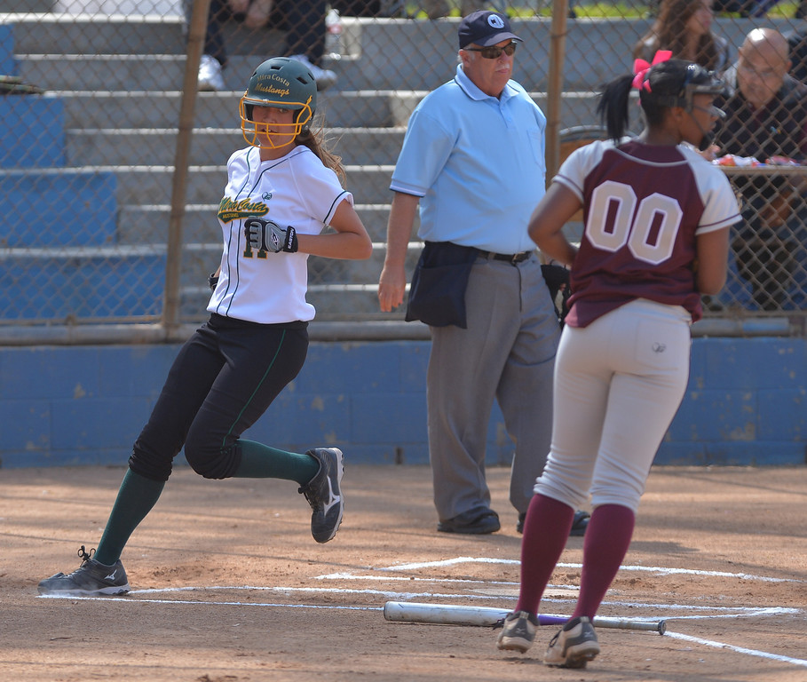 . 0517_SPT_TDB-L-MC-TORRANCE--- Torrance, CA--5/16/13--- Staff Photo: Robert Casillas  - Daily Breeze / LANG--- Mira Costa defeated Torrance High 7-1 in CIF DIV III softball playoff game at Wilson Park in Torrance. Shannon Savino comes in to score.