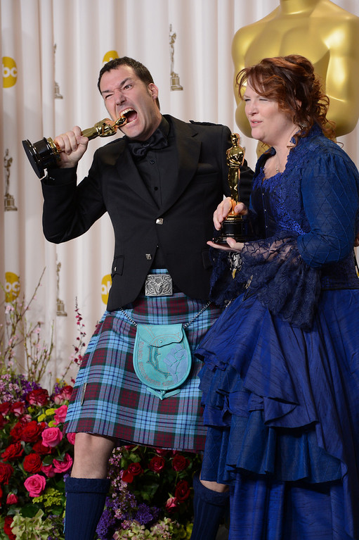 ". Mark Andrews and Brenda Chapman accept the award for best animated feature film for ""Brave\"" backstage at the 85th Academy Awards at the Dolby Theatre in Los Angeles, California on Sunday Feb. 24, 2013 ( David Crane, staff photographer)"