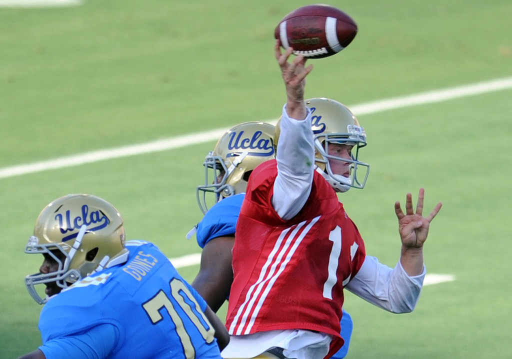 Description of . UCLA quarterback Jerry Neuheisel (11) during the football spring showcase college football game in the Rose Bowl on Saturday, April 27, 2013 in Pasadena, Calif.    (Keith Birmingham Pasadena Star-News)