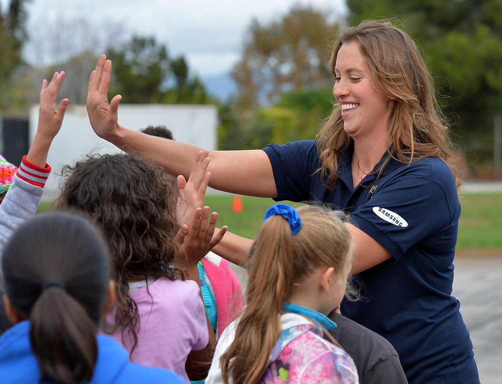 . Former Olympic swimmer Rada Owen taught a physical education class Thursday at Westport Heights Elementary in Westchester Thurssday November 21, 2013. The visit was one of 50 in Los Angeles County organized by non-profit  group Ready, Set, Gold. Owen gets high fives after class.   Photo by: Robert Casillas / Daily Breeze