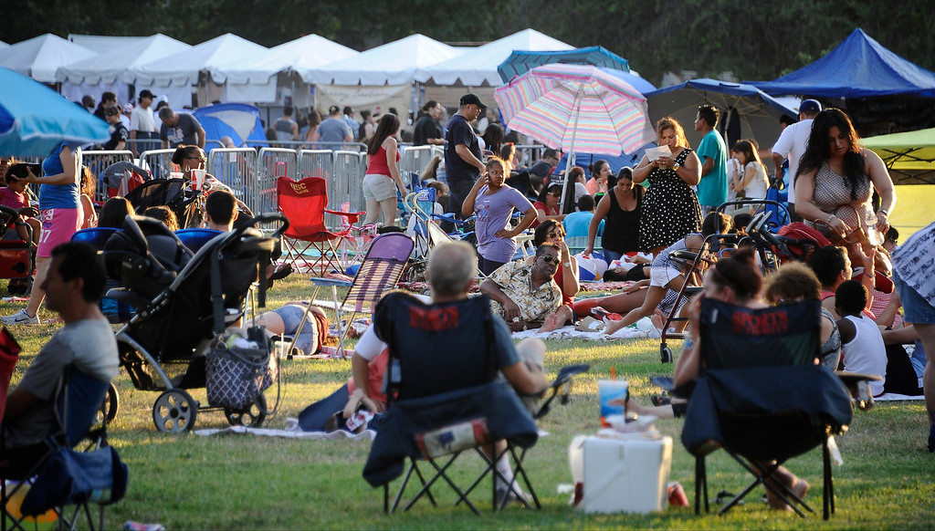 . July 4,2013 Woodland Hills.  Standing room only by 6pm at Warner Center Park during the July Fourth Fireworks Extravaganza: Keyes Automotive Group co-sponsors the event with music by the Los Angeles Pierce Symphonic who performed  Photo by Gene Blevins/LA Daily News