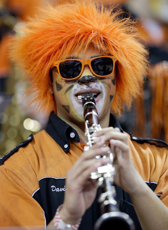 . Pacific band member David De La Vega plays before a second-round game of the NCAA college basketball tournament against the Miami Friday, March 22, 2013, in Austin, Texas.  (AP Photo/David J. Phillip)