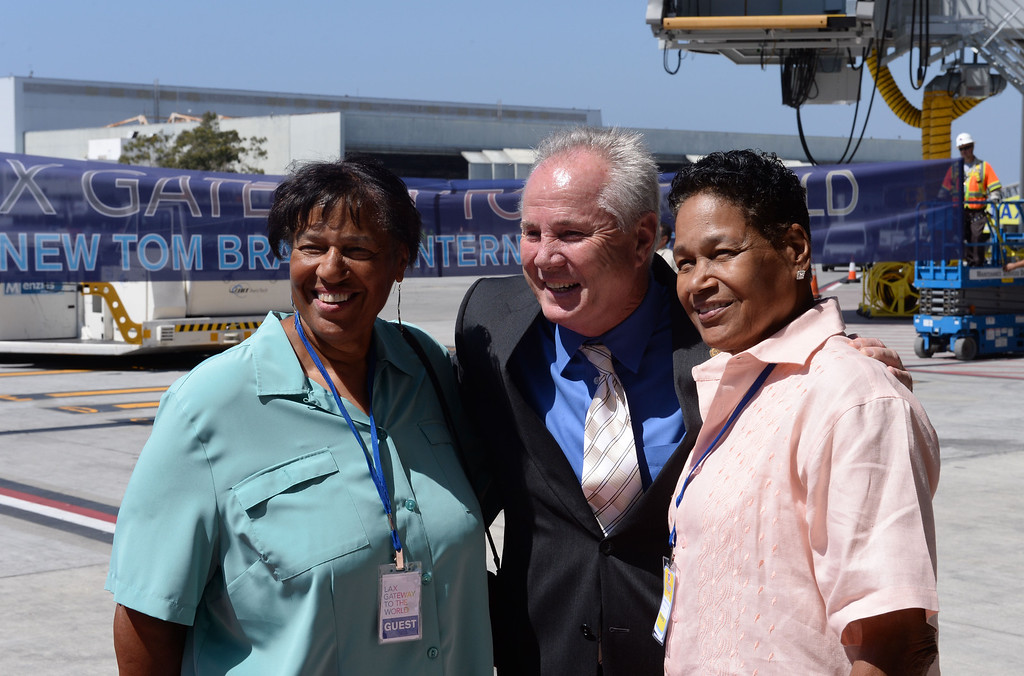 . At LAX, dignitaries gathered to open the new Tom Bradley International Terminal. Daughters of former Mayor Tom Bradley, Lorraine and Phyllis Bradley pose with Councilman Tom LaBonge.(Wed. Sept 18, 2013 Photo by Brad Graverson/The Daily Breeze