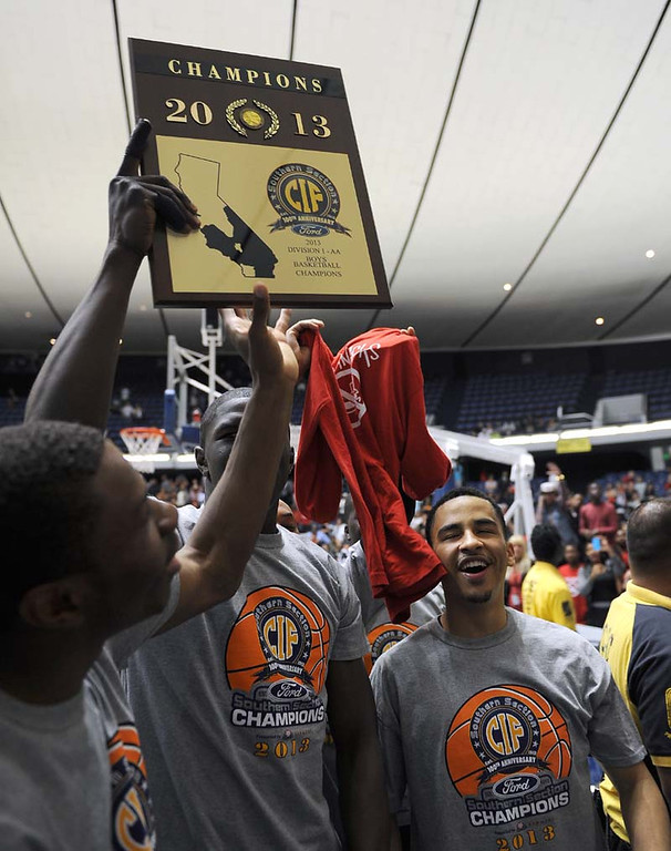 Description of . (3-2-13)--Anaheim-Sports- Etiwanda High School boy's basketball team holding up the CIF champion trophy after beating Mater Dei High School Saturday night March 2, 2013 during the CIF Ford Southren Section Boy's Division 1AA Final Championship at the Anaheim Convention Center in Anaheim.LaFonzo Carter/ Staff Photographer