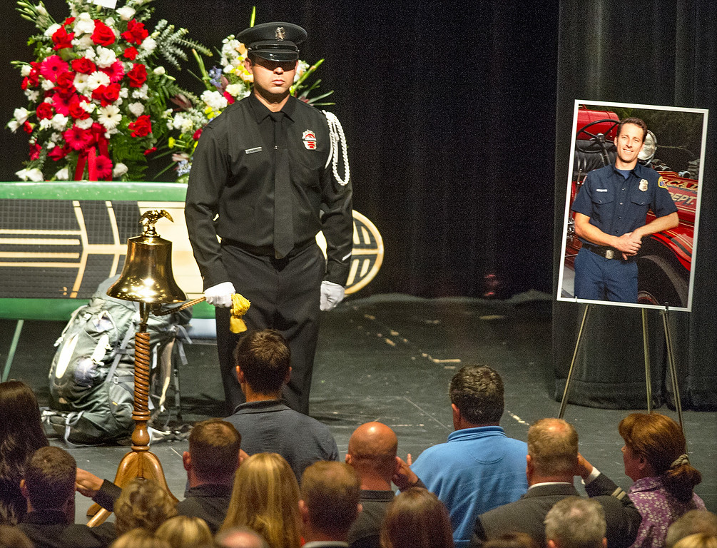 . The bell is very important in a fireman\'s life. It signals the beginning and end of their shifts. So at a funeral, it is rung one last time for the deceased firefighter as a sign of respect at Michael Herdman memorial service on Wednesday, July 9, 2014, for the Arcadia firefighter-paramedic found dead in the Los Padres National Forest last Friday. Herdman, an avid adventurer, died after becoming separated from his camping partner. He fell from a cliff and was killed by his injuries. Searchers canvassed the forest for 11 days before finding his body.(Photo by Walt Mancini/Pasadena Star-News)