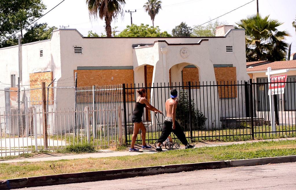 . A young couple walks along the 1200 block of North Sierra Way in San Bernardino April 22, 2013.   GABRIEL LUIS ACOSTA/STAFF PHOTOGRAPHER.