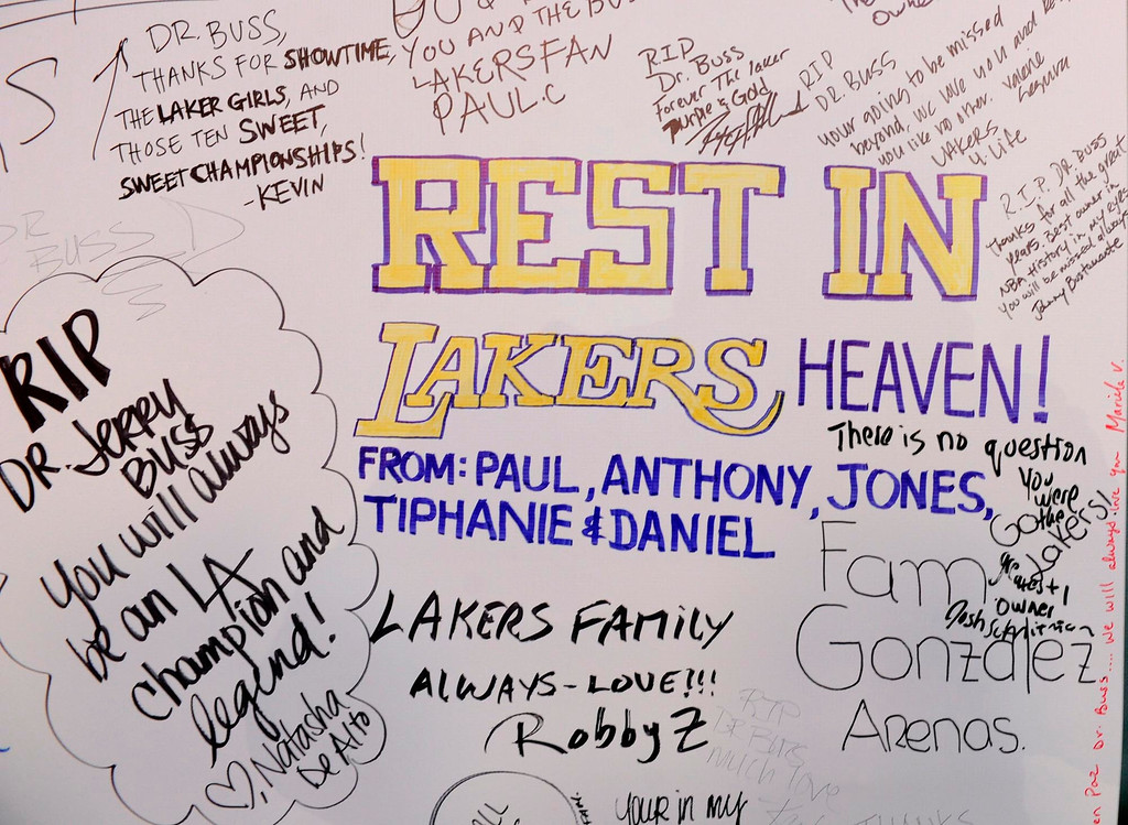 . The Lakers posted large banners around LA Live and Staples Center with a photo of Jerry Buss and plenty of room for fans to write their best wishes. Los Angeles, CA 2/20/2013(John McCoy/Staff Photographer)