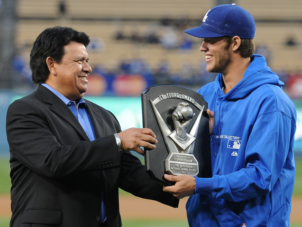 . Former Dodger great Fernando Valenzuela presents the Cy Young Award to Clayton Kershaw before the game. The Dodgers played host to the Pittsburgh Pirates in a game played at Dodger Stadium in Los Angeles, CA 4/11/2012(John McCoy/Staff Photographer)