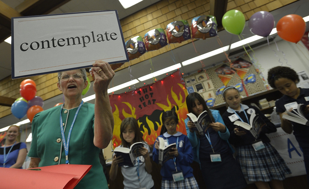 """. LONG BEACH, CALIF. USA -- Children\'s librarian Gail Tweedt shows off a word during a game at the El Dorado Beach Library in Long Beach, Calif., on February 28, 2013. This is the 10th. year that dictionaries have been purchased and distributed to third-grade students in the Long Beach Unified School District, charter, local parochial and private schools. The Long Beach Dictionary Project promotes literacy and the goal that all students will leave third-grade at the end of the year as \""""good writers, active readers, and creative thinkers\"""". The Miller Foundation, which has been providing dictionaries to third-graders since 2003, is celebrating giving away its 100,000 lexicon literary.  Photo by Jeff Gritchen / Los Angeles Newspaper Group"""