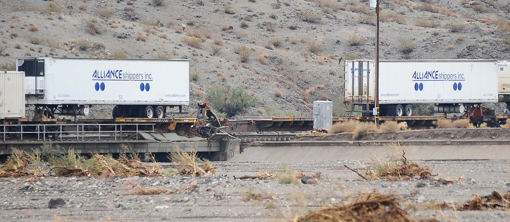 . A box car on a train was knock off the tracks along highway 95 just north of highway 40 west of Needles California Sunday afternoon Aug 25th. Drivers were stuck for hours until Caltrans arrived late in the evening to start to remove the mud that came from heavy monsoon storms today in the deserts areas. Needles CA, Aug 25,2013. Photo by Gene Blevins/LA Daily News