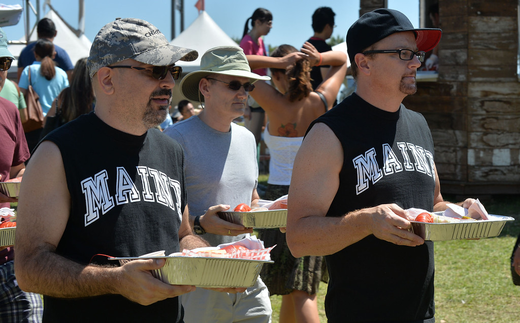 . The 17th Annual Original Lobster Festival at Rainbow Lagoon Sunday, September 08, 2013, in Long Beach.  Sporting Maine t-shirts, people look for a table with their Maine lobsters at the festival. Photo by Steve McCrank / Daily Breeze