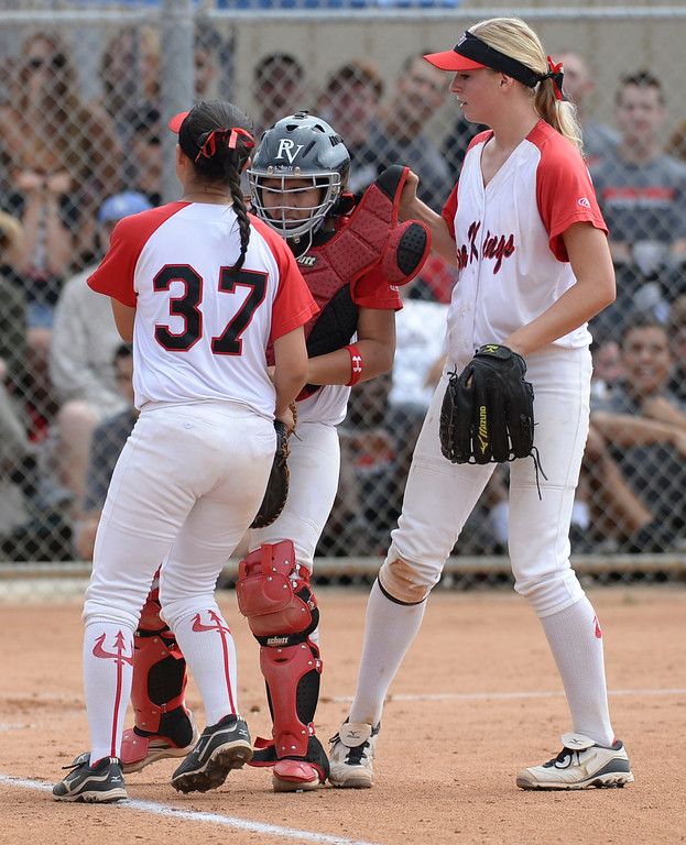 . Palos Verdes catcher Allison Benitez (17) is restrained by teammates Courtney Brown (37) and Johniann Wahl (44) after she had tangled with St. Paul\'s Sydney Kreimann (18) in a CIF-SS Division III semifinal softball game Tuesday, May 27, 2014, Palos Verdes Estates, CA.  Palos Verdes lost 10-0. Photo by Steve McCrank/Daily Breeze