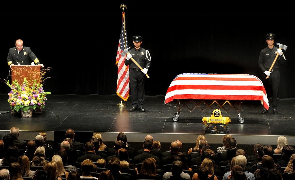 Description of . Arcadia Fire Chief Kirt Norwood speaking  warmly about the life of Michael Herdman at memorial service on Wednesday, July 9, 2014, for the Arcadia firefighter-paramedic found dead in the Los Padres National Forest last Friday. Herdman, an avid adventurer, died after becoming separated from his camping partner. He fell from a cliff and was killed by his injuries. Searchers canvassed the forest for 11 days before finding his body.(Photo by Walt Mancini/Pasadena Star-News)