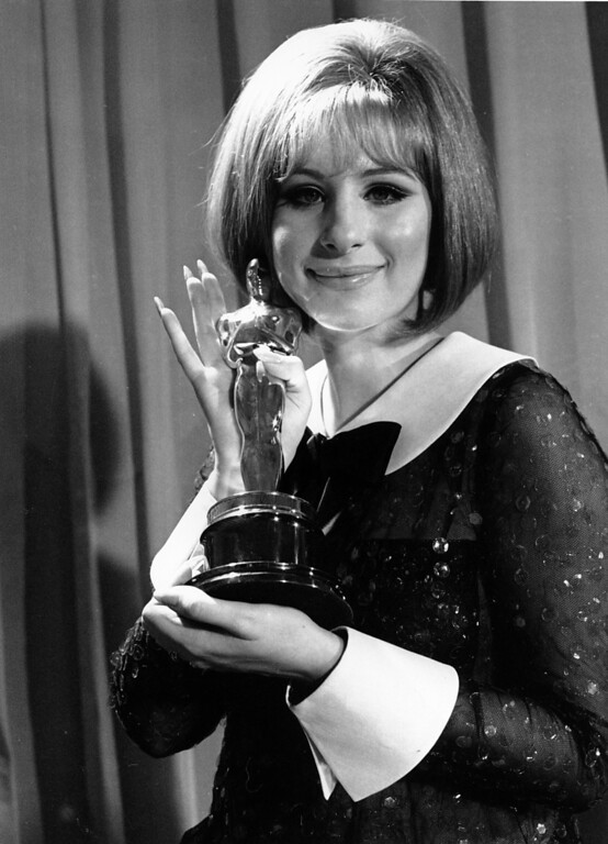 ". Barbra Streisand poses with her Oscar in Hollywood,Ca. on April 14, 1969. Streisand won the Academy Award for her performance in ""Funny Girl.\""  (AP Photo/stf)"