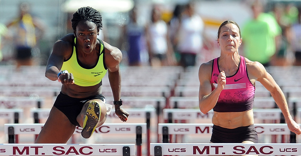 Description of . Yvette Lewis, left, of Brooks wins the 100 meter hurdles invitational elite as Jessica Zelinka of NYAC Nike finished third during the Mt. SAC Relays in Hilmer Lodge Stadium on the campus of Mt. San Antonio College on Saturday, April 20, 2012 in Walnut, Calif.    (Keith Birmingham/Pasadena Star-News)
