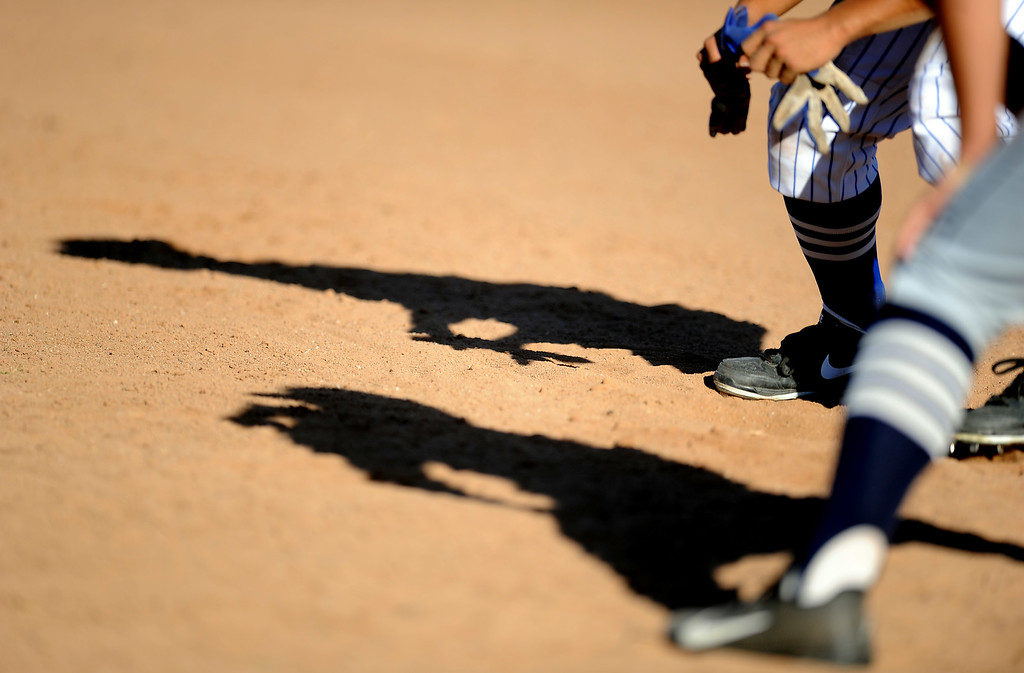 . Bishop Amat\'s Andrew Dela Cruz leads off first base ahead of St. Paul first baseman Kevin Lugo in the third inning of a prep baseball game at Bishop Amat High School on Friday, April 19, 2012 in La Puente, Calif. Bishop Amat won 3-2.    (Keith Birmingham/Pasadena Star-News)