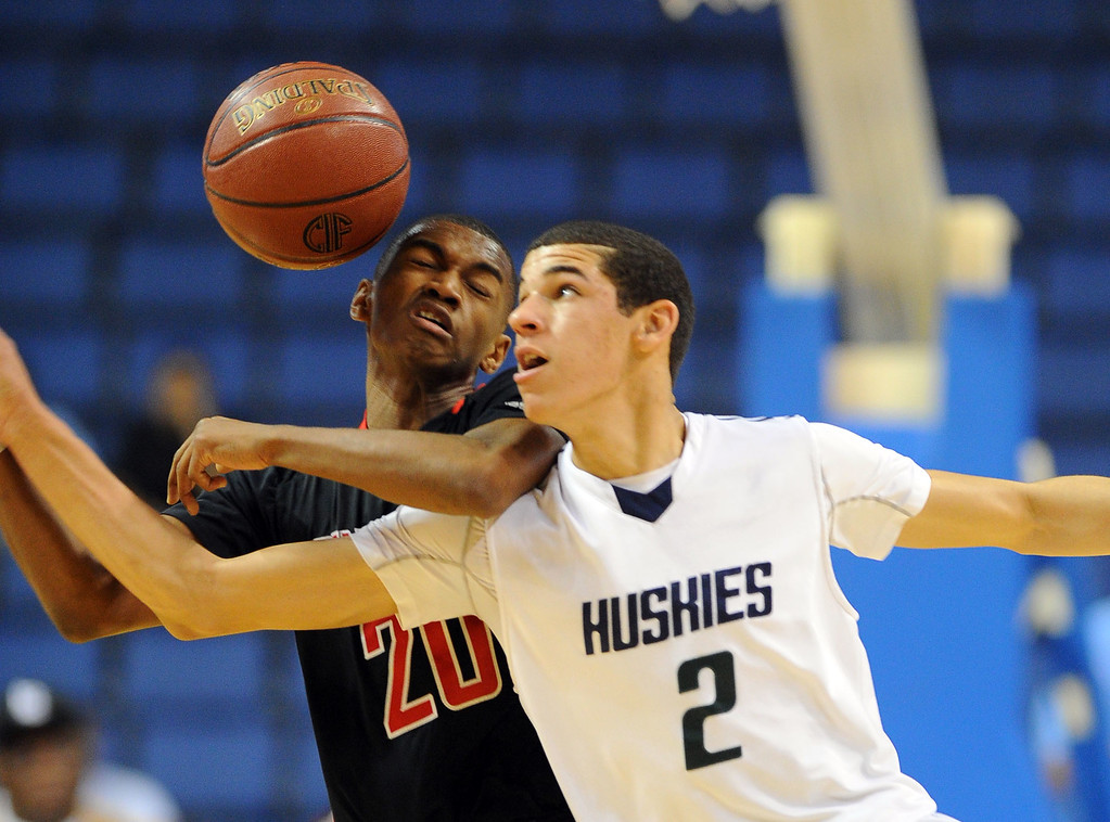 . Chino Hills\' Lonzo Ball strips the ball from Centennial\'s Chris Famous at Citizens Business Bank Arena in Ontario, CA on Saturday, March 22, 2014. Chino Hills vs Centennial in the CIF boys Div 1 regional final. 1st half. Photo by Scott Varley, Daily Breeze)