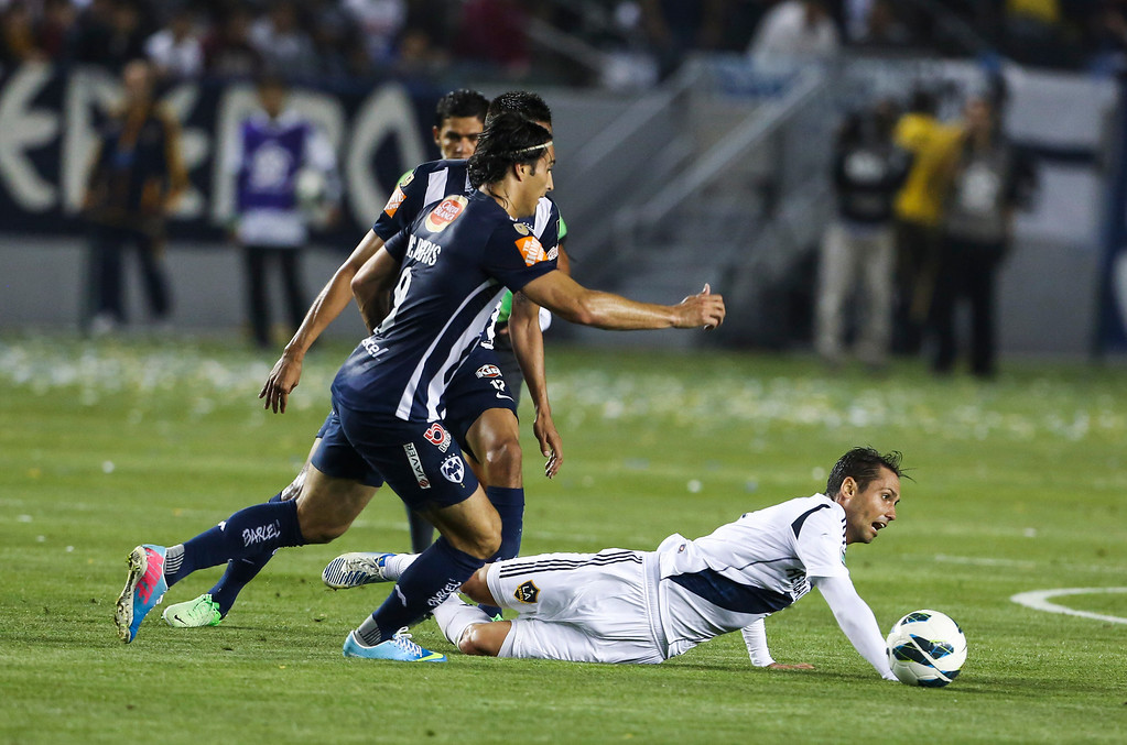 . Los Angeles Galaxy midfielder Marcelo Sarvas is fouled during the CONCACAF Champions League semifinal, Wednesday, April 3, 2013, in Carson, Calif. Monterrey won 2-1. (AP Photo/Bret Hartman)