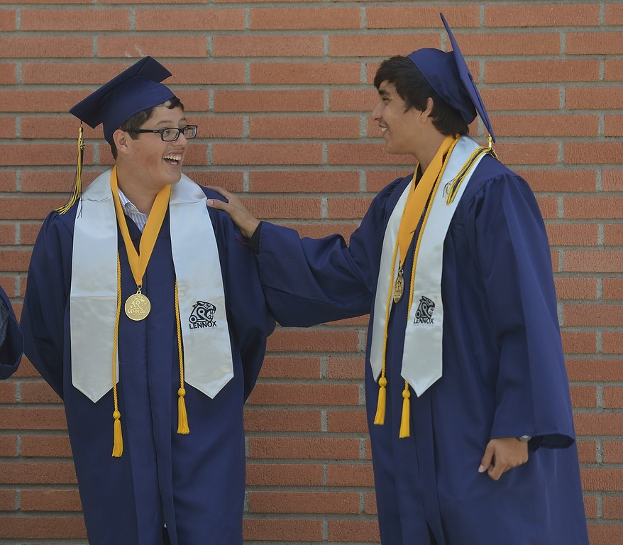 . TORRANCE, CALIF. USA -- Daniel Navarro and Raul Duenas before commencement ceremonies for Lennox Math, Science & Technology Academy at El Camino College in Torrance, Calif., on June 8, 2013.   Photo by Jeff Gritchen / Los Angeles Newspaper Group