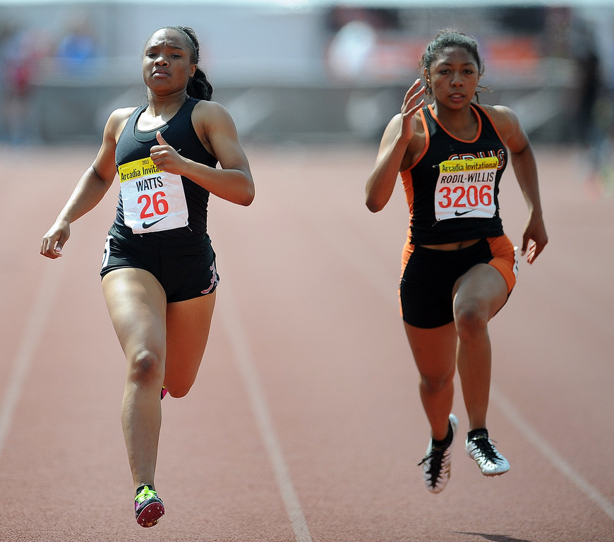 Description of . Alemany's Asia Watts, left, along with South Pasadena's Kamia Rodil Willis competes in the 200 meters race in the during the Arcadia Invitational at Arcadia High School on Saturday, April 6, 2013 in Arcadia, Calif.  (Keith Birmingham Pasadena Star-News)