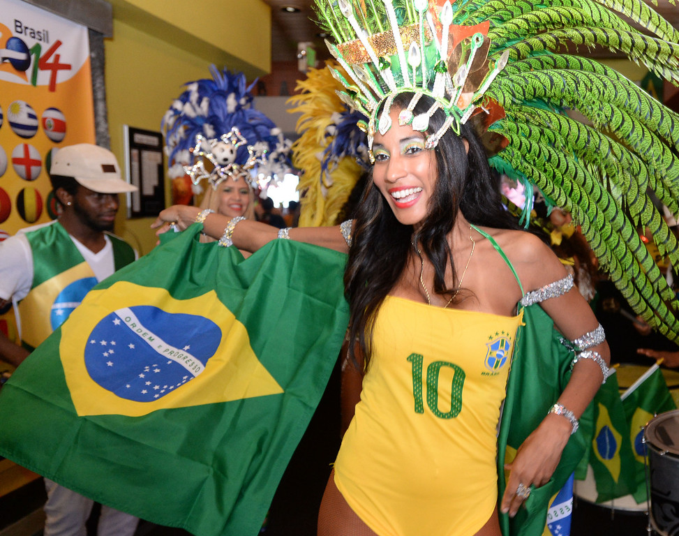 . Joany Macias, leads the Los Angeles Samba Dancers as Brazil soccer fans crowded into Samba restaurant to watch the FIFA World Cup game against Croatia Thursday, June 12, 2014, Redondo Beach, CA.  The South Bay is home to a large Brazilian community. Photo by Steve McCrank/Daily Breeze