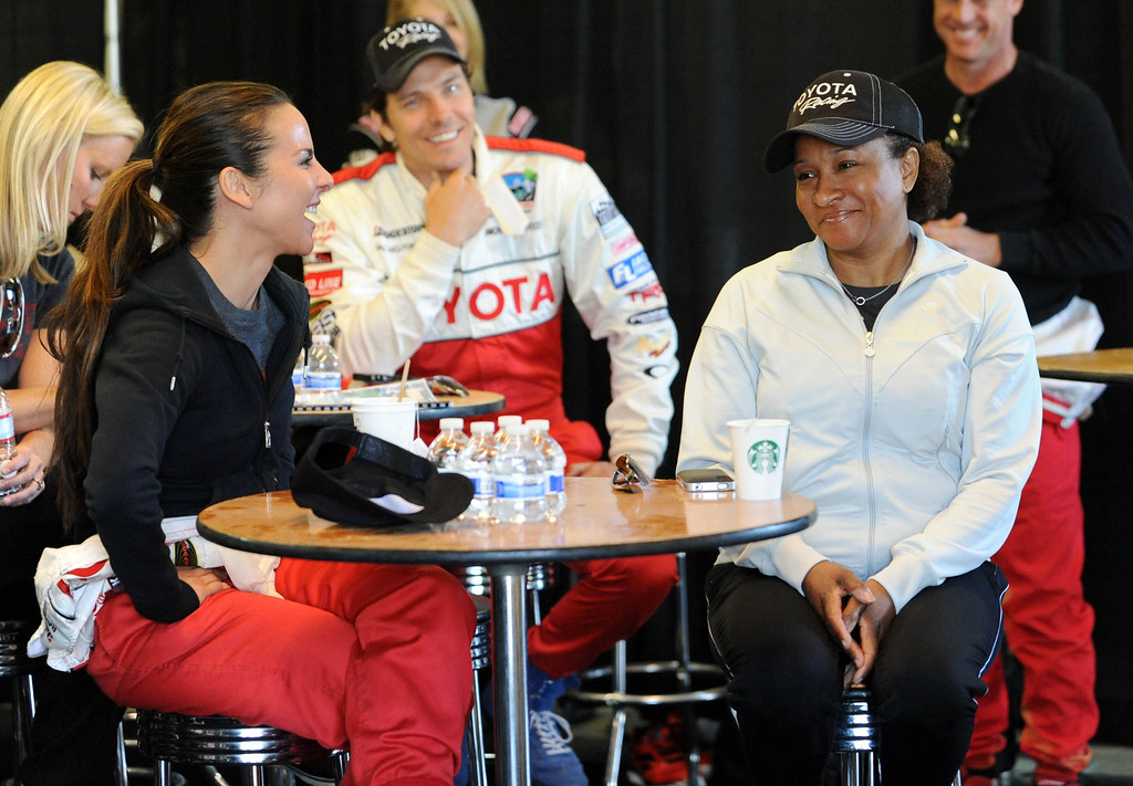 . Rosamond, Calif., -- 03-23-13-  Toyota Pro/ Celebrity Race participants actress Kate del Castillo,left,  and comedian and actress Wanda Sykes,  before a practice session at Willow Springs Raceway. The Toyota Pro/Celebrity Race helps raise money on behalf of Racing for Kids, a fundraising program benefiting Miller Children�s Hospital in Long Beach and Children�s Hospital of Orange County. On behalf of the race and its participants, Toyota has donated more than $2 million to various children�s hospitals since 1991.  Stephen Carr/  Los Angeles Newspaper Group