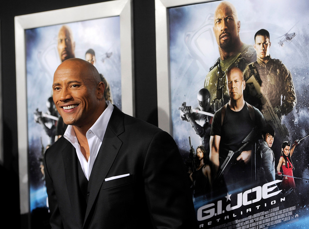 ". Dwayne Johnson, a cast member in ""G.I. Joe: Retaliation,\"" poses at the Los Angeles premiere of the film at the TCL Chinese Theatre on Thursday, March 28, 2013 in Los Angeles. (Photo by Chris Pizzello/Invision/AP)"