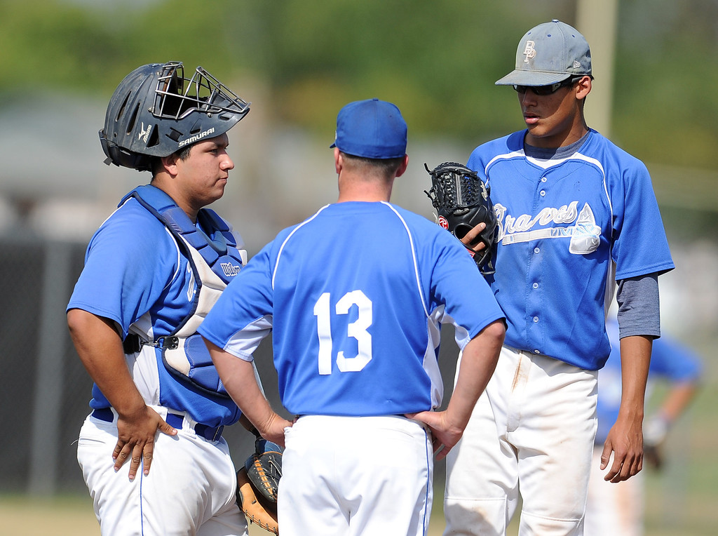 Description of . Baldwin Park head coach Jake Barendregt (13) talks with starting pitcher Bernardo Flores ©, right, as catcher Daniel Escobedo looks on in the first inning of a prep baseball game at Northview High School on Tuesday, April 23, 2012 in Covina, Calif. Northview won 8-2.    (Keith Birmingham/Pasadena Star-News)