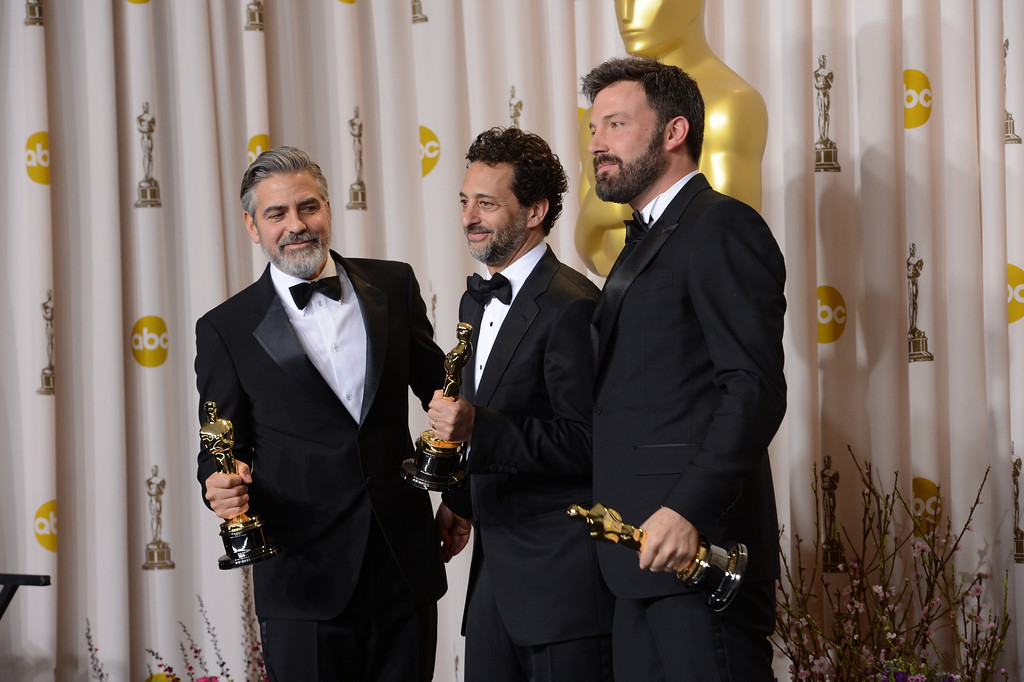 """. George Clooney, Grant Heslov, and Ben Affleck, accepts the award for best picture for \""""Argo\""""  backstage at the 85th Academy Awards at the Dolby Theatre in Los Angeles, California on Sunday Feb. 24, 2013 ( David Crane, staff photographer)"""