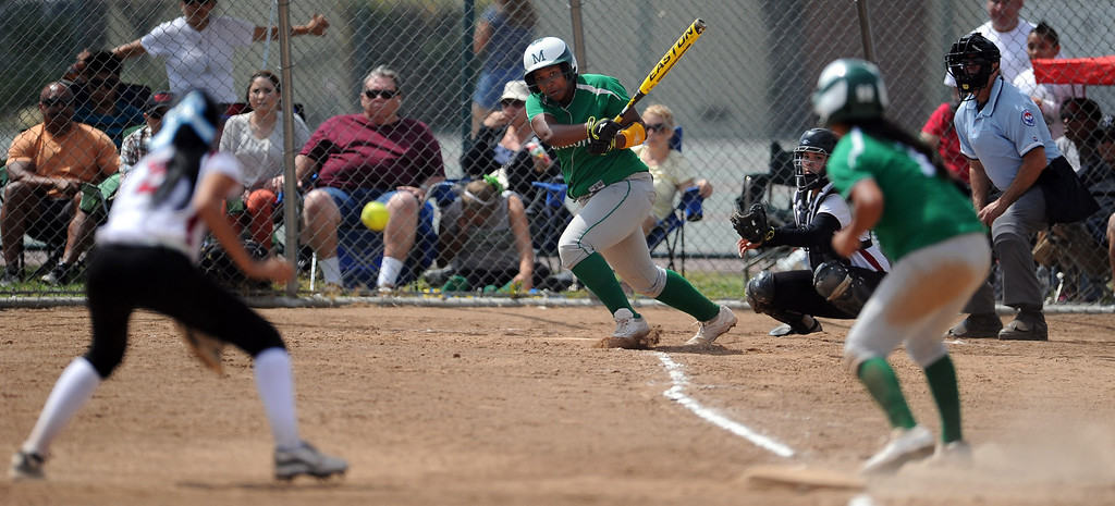 Description of . Monrovia's Derek Blow doubles down line for a RBI in the third inning of the Northview Tournament championship softball game against Covina at Northview High School on Thursday, April 4, 2013 in Covina, Calif.  Monrovia won 6-0. 