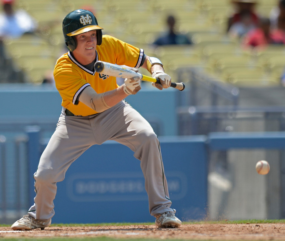 . Mira Costa\'s Braden Cassady lays down a bunt in the CIF-SS Division III championship baseball game Friday at Dodger Stadium. Serra won the title, 8-1. 20130531 Photo by Steve McCrank / Staff Photographer