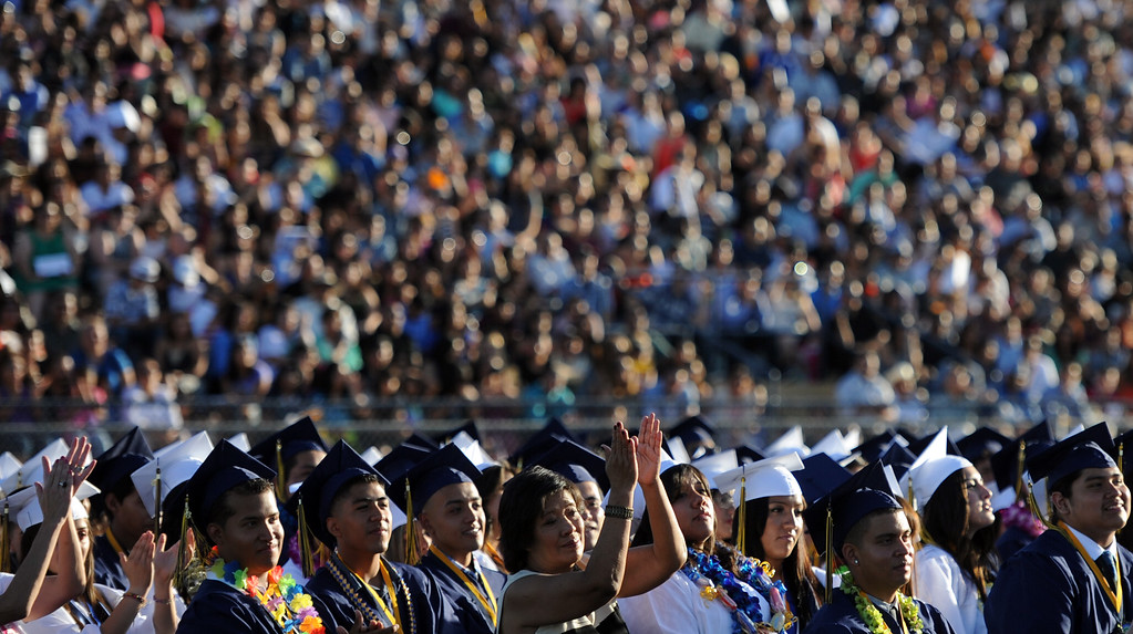 Description of . Students along with family and friends look on during the Montebello High School commencement at Montebello High School on Thursday, June 20, 2013 in Montebello, Calif.  (Keith Birmingham/Pasadena Star-News)