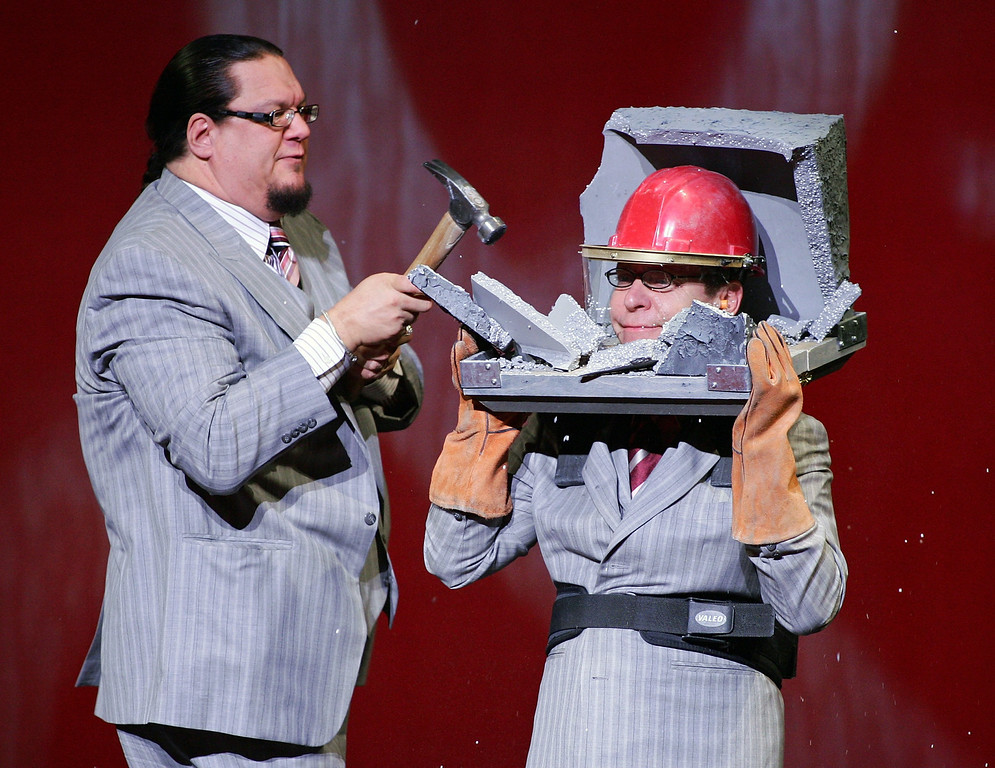 . LAS VEGAS - OCTOBER 18:  Penn Jillette (L) and Teller of the comedy/magic duo Penn & Teller perform at the Rio Hotel & Casino during a show celebrating five years of performances at the resort October 18, 2007 in Las Vegas, Nevada.  (Photo by Ethan Miller/Getty Images)