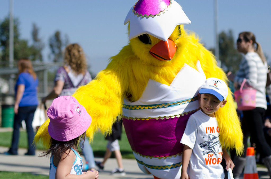 . Sidnay Banh, left, 2, and Anson Banh, 4, prepare to get their photo taken with an Easter chick at City of Diamond Bar\'s Easter Egg Hunt, hosted by the Diamond Bar Breakfast Lions Club at Pantera Park, in Diamond Bar, Calif., Saturday, March 30, 2013.Children were handed Easter eggs, prizes and candy were made available to children. (SGVN/Correspondent photo by Anibal Ortiz)
