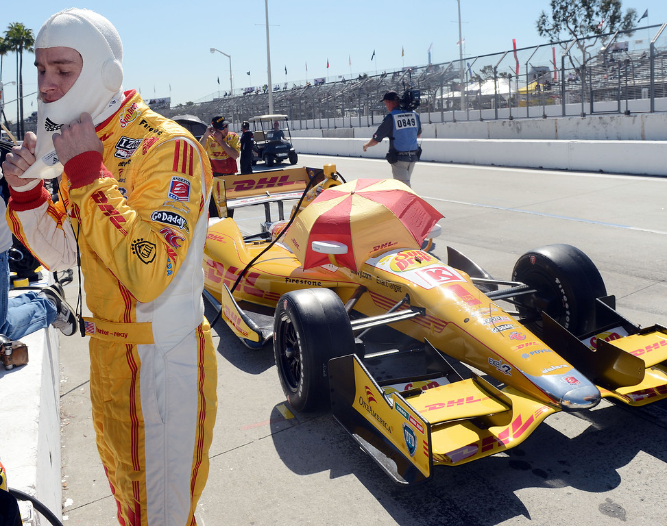 . (Will Lester/Staff Photographer)  Indycar driver Ryan Hunter-Reay prepares to enter his race car in the pits Friday morning April 19, 2013 at the 39th annual Toyota Grand Prix of Long Beach.