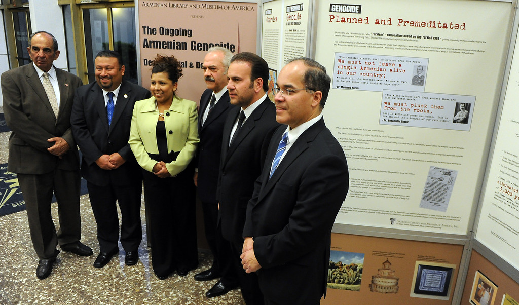 . Local government officials pose for a photograph in front of a traveling Armenian Genocide display at the Montebello City Hall on Wednesday, April 10, 2012 in Montebello, Calif. It is the 98th anniversary of the genocide, which occurred between 1915-1923.   (Keith Birmingham/Pasadena Star-News)