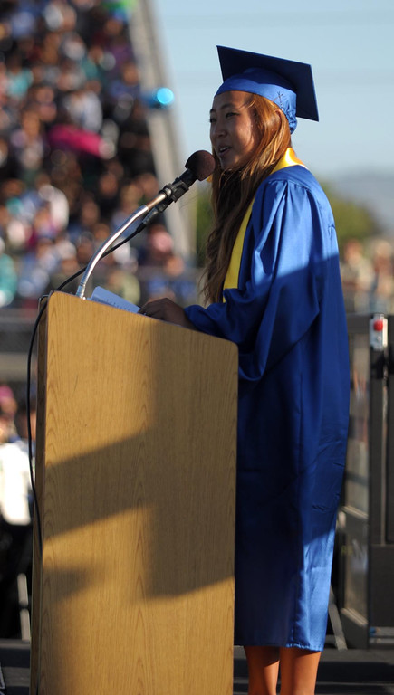 . Alice Jeong speaks to her fellow seniors. The 2013 North High School commencement ceremonies take place on the school\'s football field in Torrance Wednesday afternoon.