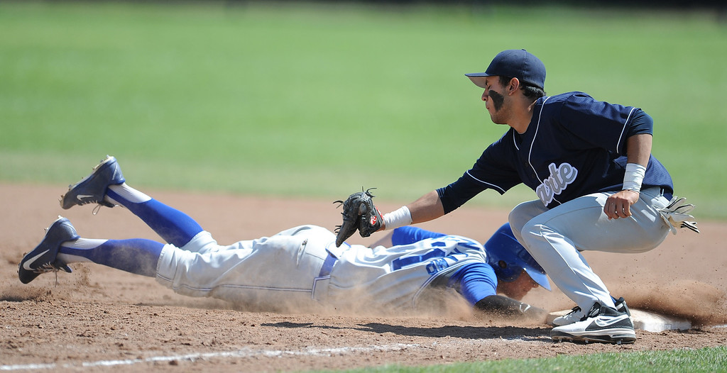 Description of . Charter Oak's Kevin Ecternkamp (31) dives back safe at first ahead of the tag by Duarte first baseman Jonathon Sandoval in the third inning of the Championship game of the Gladstone Baseball Tournament at Gladstone High School on Wednesday, April 3, 2013 in Covina, Calif. Charter Oak won 5-3. (Keith Birmingham Pasadena Star-News)