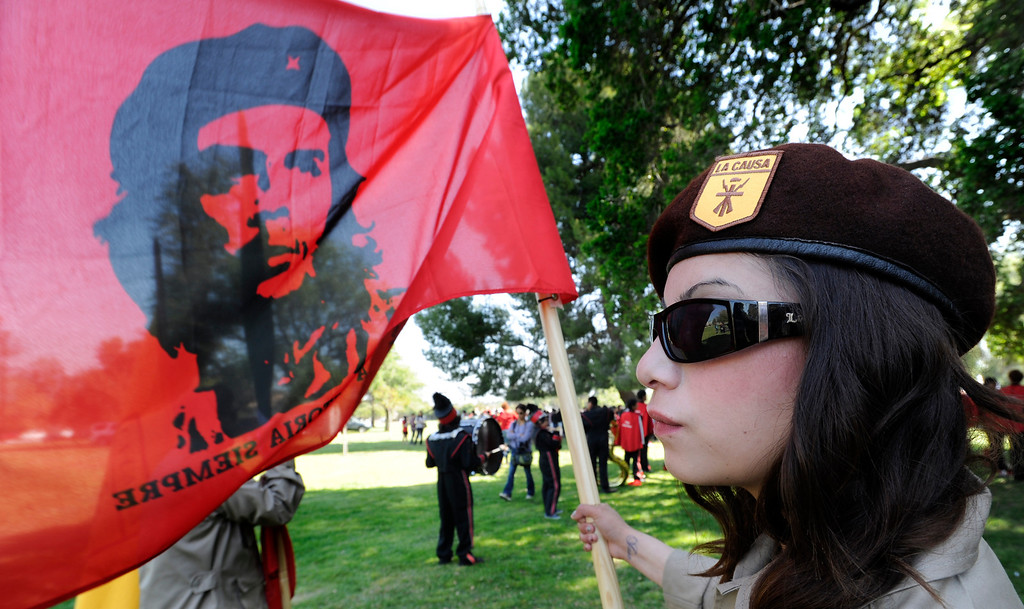. Kyana Aguayo flys the flag of Che Guevara while wearing the uniform of a Brown Beret. Approximately 4,000 Angelinos marched 2 miles from Brand Park to Ritchie Valens Park during the Annual Cesar Chavez March for Justice. Mission Hills, CA 3/23/2013(John McCoy/Staff Photographer