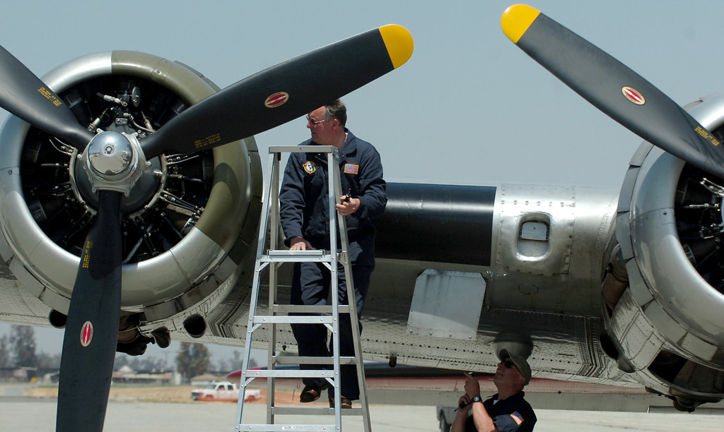 . Ken Morris, left co-pilot, looks at one of the engines on a WWII B-17 Bomber in Chino April 29, 2013. he Boeing B-17 Flying Fortress is a World War II bomber used primarily in Europe. B-17s from the Eighth Air Force participated in countless missions from bases in England. These missions often lasted for more than eight hours and struck at targets deep within enemy territory. Because of their long-range capability, formations of B-17s often �ew into battle with no �ghter escort, relying on their own defensive capabilities to ensure a successful mission. (Thomas R. Cordova/Staff Photographer)