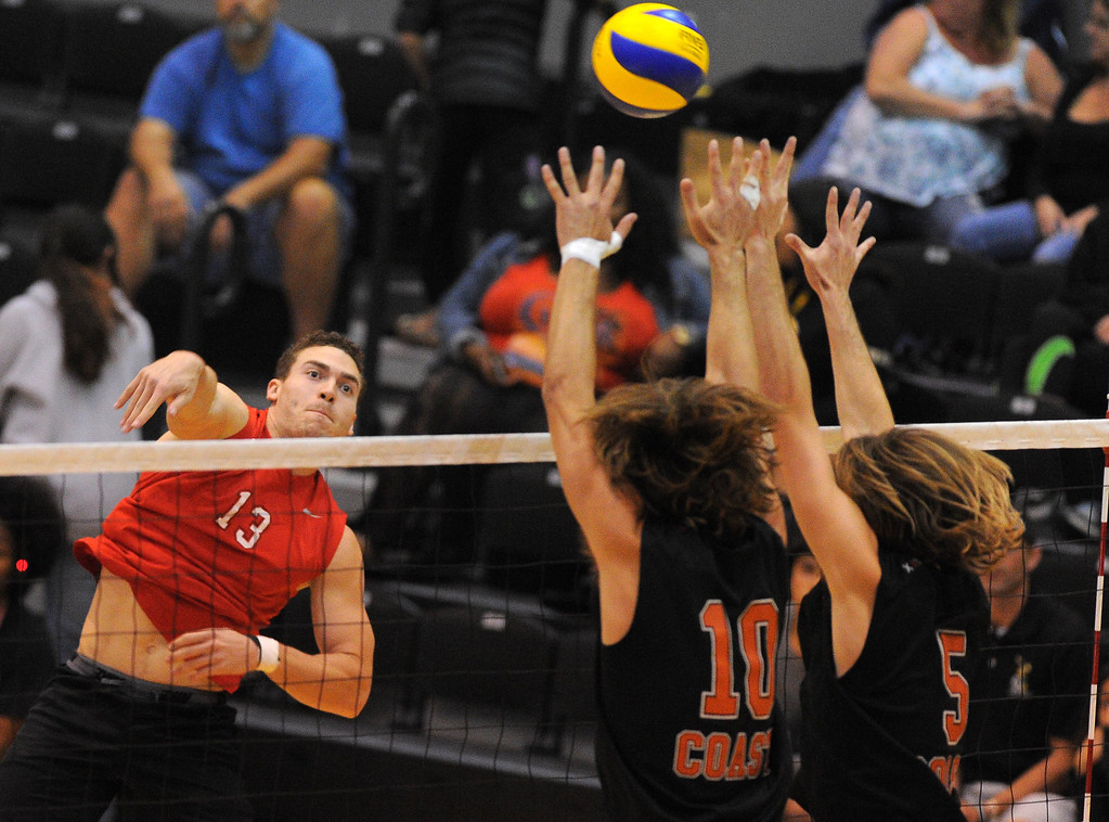 . LONG BEACH - 04/16/2013  (Photo: Scott Varley, Los Angeles Newspaper Group)  Long Beach City College defeated Orange Coast College to advance to the semifinal in the state mens volleyball playoffs. LBCC\'s Jon Schaefer hits over Austin Bagby and Brendan Duff, right.