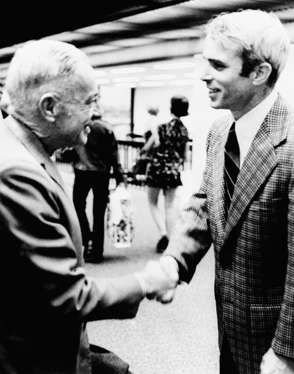 . In this March 31, 1973 photo, Adm. John S. McCain Jr., left, and his son, Lt. Cmdr. John S. McCain III meet for the first time in Jacksonville, Fla.  As the last U.S. combat troops left Vietnam 40 years ago, angry protesters still awaited them at home. North Vietnamese soldiers took heart from their foes\' departure, and South Vietnamese who had helped the Americans feared for the future. While the fall of Saigon two years later � with its indelible images of frantic helicopter evacuations � is remembered as the final day of the Vietnam War, Friday marks an anniversary that holds greater meaning for many who fought, protested or otherwise lived it. (AP Photo)