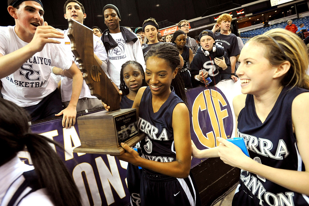 . Sierra Canyon High School players carry the State Championship trophy after they defeated Pinewood 47-33 during the 2013 CIF State Basketball Championships at the Sleep Train Arena, in Sacramento, Ca March 22, 2013.(Andy Holzman/Los Angeles Daily News)