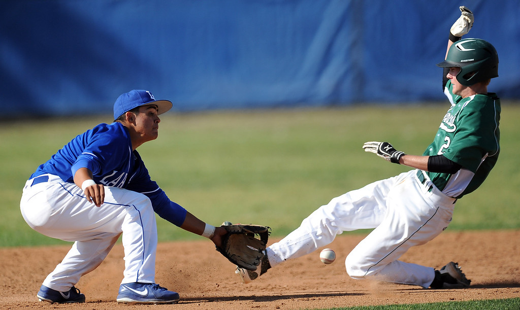 . La Habra second baseman Marcus Lopez tags out Bonita\'s Austin McGilvra (2) on a attempted of steal at second base in the sixth inning of a prep baseball game at La Habra High School on Tuesday, April 2, 2013 in La Habra, Calif. Bonita won 8-2.  (Keith Birmingham Pasadena Star-News)